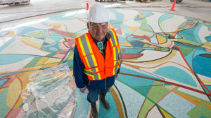 Alex Janvier stands with Photo by: Jeff Nash / Edmonton Oilers